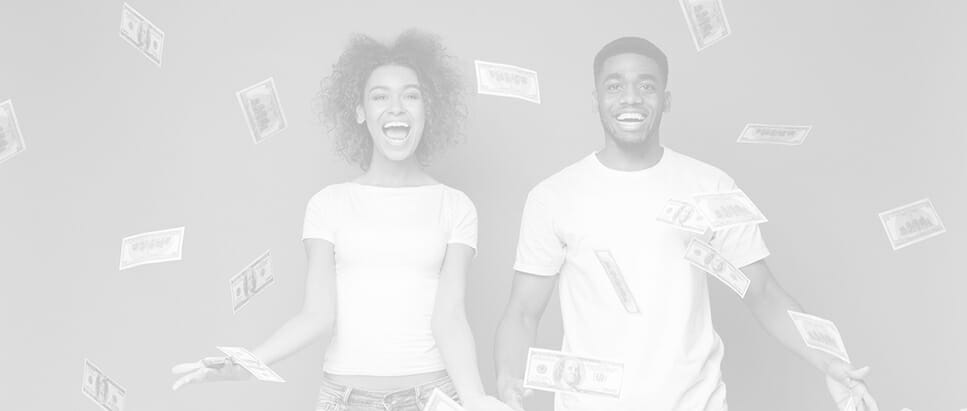a couple smiling and laughing while money flies in air