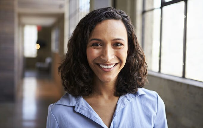smiling woman in hallway