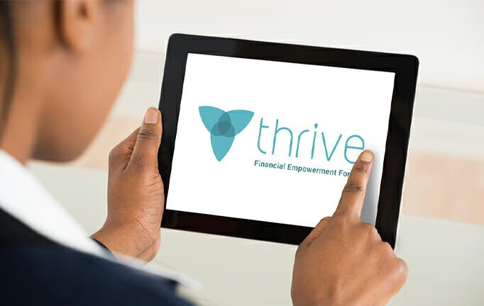person using tablet to view Thrive website